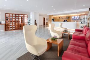 The lobby or reception area at Hotel Lancelot