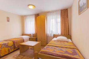 Кровать или кровати в номере Zolotaya Bukhta