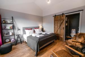 A bed or beds in a room at Frost and Fire Hotel