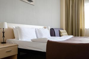 Кровать или кровати в номере Atlantic by USTA Hotels