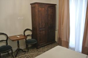 Letto o letti in una camera di Palazzo Zecchino