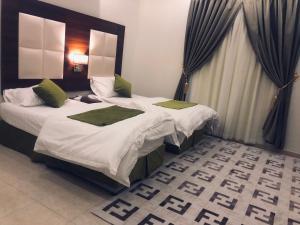 Cama ou camas em um quarto em Road Side Suites