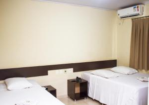 A bed or beds in a room at Alkimia Hotel