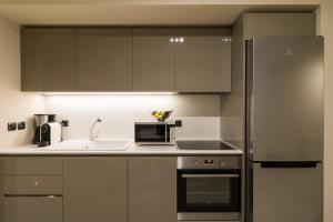 A kitchen or kitchenette at Athens Mosaico Suites & Apartments