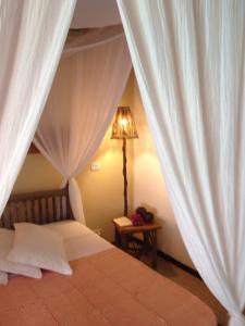 A bed or beds in a room at Pousada Residencia Duna Paraiso
