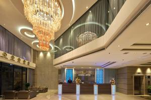 The lobby or reception area at Athena Hotel