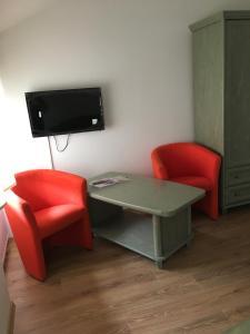 Televízia a/alebo spoločenská miestnosť v ubytovaní Penzión Petrov grunt