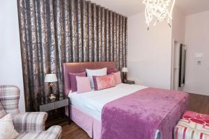 Ein Bett oder Betten in einem Zimmer der Unterkunft Hotel Prinz Anton