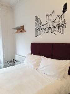 Cama o camas de una habitación en McMillan House Studio Apartments