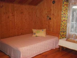 A bed or beds in a room at Zīļulejas