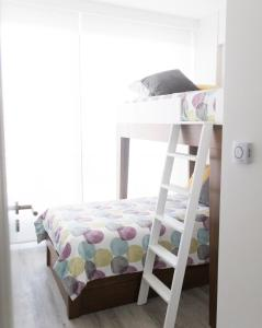 A bunk bed or bunk beds in a room at Belgrano Luminous and Nordic Style