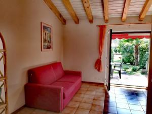 A seating area at Signora Ruth - Aprilia Residence