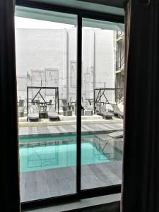 A view of the pool at Zenvea Hotel or nearby