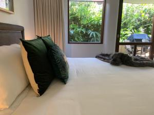 A bed or beds in a room at Beach Suites