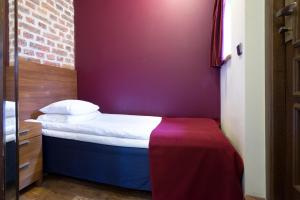 A bed or beds in a room at Rex Hotel