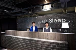The lobby or reception area at Just Sleep - Ximending