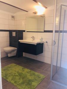 Ein Badezimmer in der Unterkunft Marschenhof am See Xanten