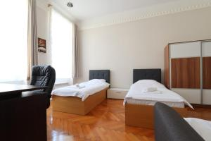 A bed or beds in a room at Sarajevo Eternal Flame apartment