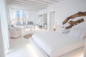 A bed or beds in a room at Paros Palace