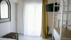A television and/or entertainment center at Il nido dei gufi