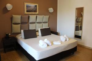 A bed or beds in a room at Hotel Franchi