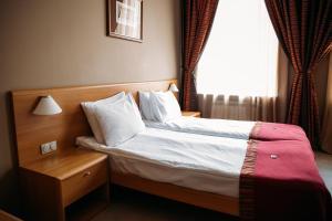 Кровать или кровати в номере Гостиница Эгоист