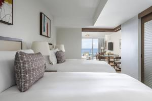 A bed or beds in a room at The Ritz-Carlton Residences, Waikiki Beach Hotel