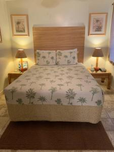 A bed or beds in a room at Kauai Palms Hotel