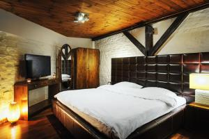 A bed or beds in a room at Apartamenty Chleb i Wino Toruń