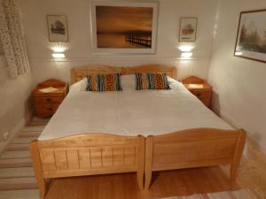 Säng eller sängar i ett rum på Prästmyrens Vandrarhem