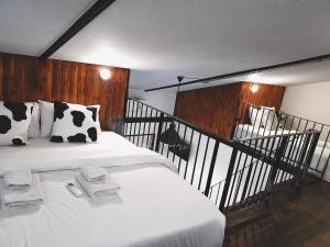 A bed or beds in a room at Oxotel Hotel