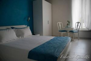 Letto o letti in una camera di Rooms & Breakfast Il Punto...