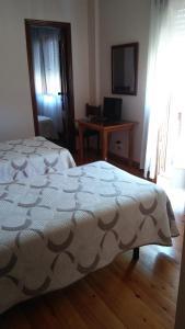 Cama o camas de una habitación en Hotel El Sueve