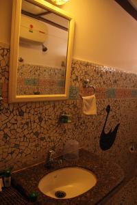 A bathroom at WelcomHeritage Panjim Inn