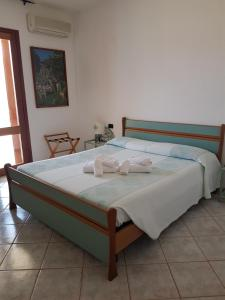 A bed or beds in a room at Hotel Il Platano