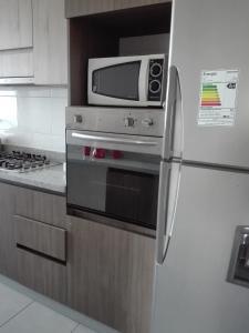 A kitchen or kitchenette at Departamento por días-semanas para empresas