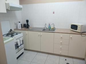 A kitchen or kitchenette at Rantzo Holiday Apartments