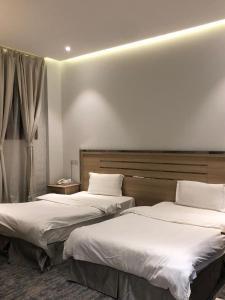 Cama ou camas em um quarto em Hala Onaizah