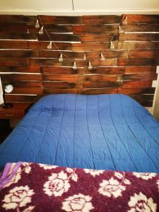 A bed or beds in a room at La Minga Hostel