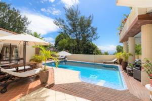 The swimming pool at or near Carana Hilltop Villa