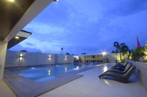 The swimming pool at or near Holiday Suites