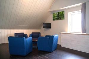 A seating area at Fletcher Landhotel Bosrijk Roermond