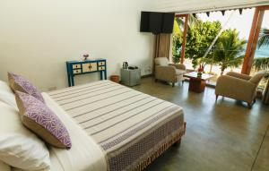 A bed or beds in a room at Ubuntu Beach Villas by Reveal