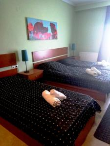 A bed or beds in a room at Assembly Hotel
