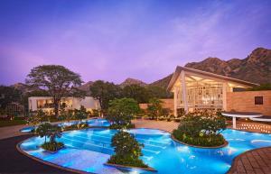 The swimming pool at or near Taj Aravali Resort & Spa Udaipur