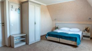 Кровать или кровати в номере Отель Коржовъ