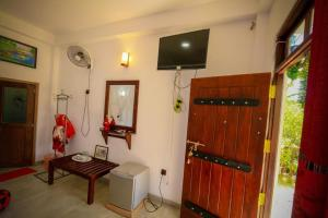 A television and/or entertainment center at Snuggle Cottage