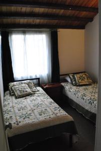 A bed or beds in a room at Hostal familiar la Alborada