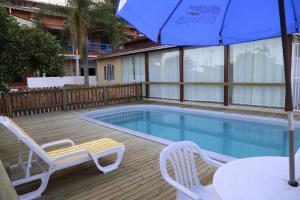 A piscina localizada em Pousada Oceânica ou nos arredores