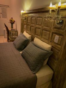 A bed or beds in a room at Pousada Villa Real